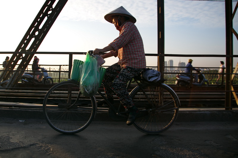 Vendors cross the Long Bien bridge in Hanoi